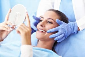 Picture of adult woman having a visit at the dentist's