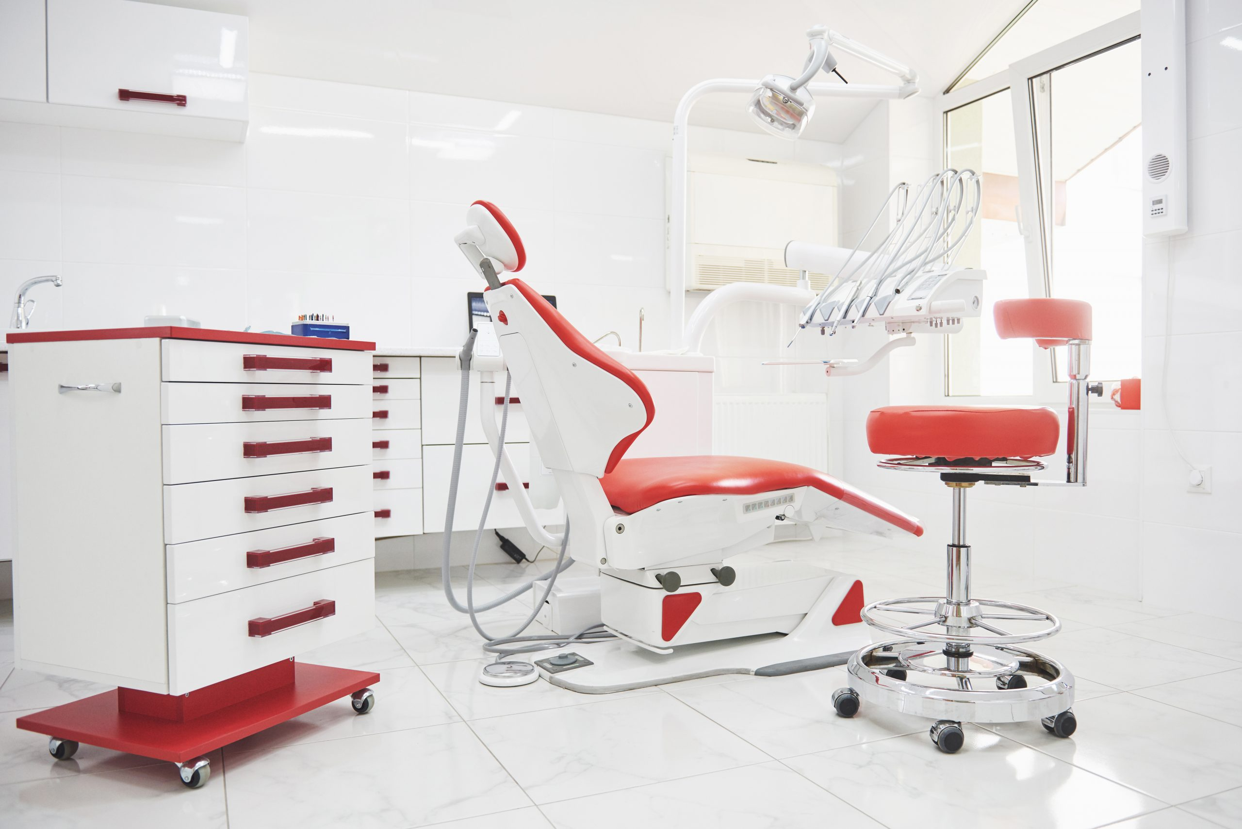 Dental clinic interior, design with chair and tools. All furniture in the same color.